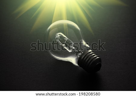 Halogen light bulb on dark background with flare.