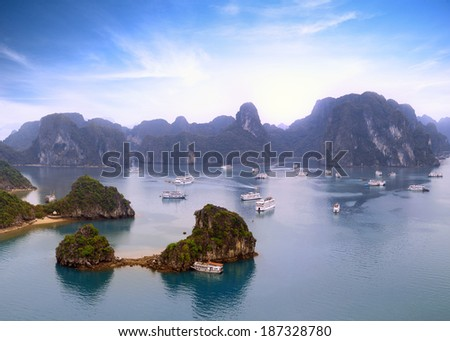 Halong Bay Vietnam panoramic view background. Mountains, islands and tourist boats on beautiful sea landscape - stock photo