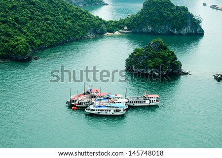 HALONG, VIETNAM - JUNE 22 : Tourist Junks in Halong Bay, Vietnam on June 22,2013. Ha Long Bay is a UNESCO World Heritage Site