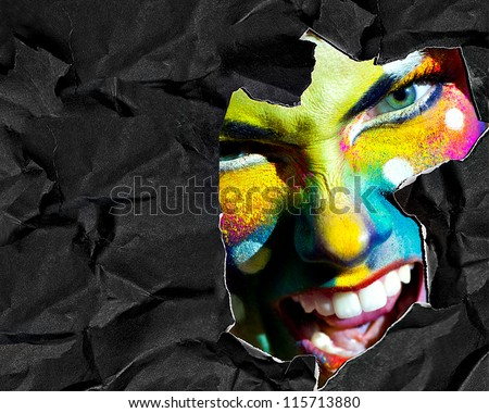 Haloween women color face art mad portrait black crumpled torn paper background white teeth evil smiling copy space - stock photo