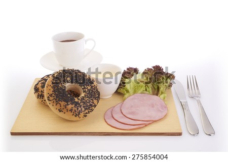 ham and  bagel with coffee on cutting board in isolated white background - stock photo