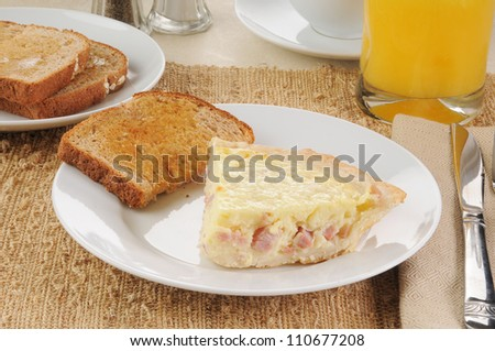 Ham and cheese quiche Lorraine with toast
