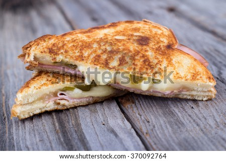 ham and cheese sandwich on rustic wooden table - stock photo