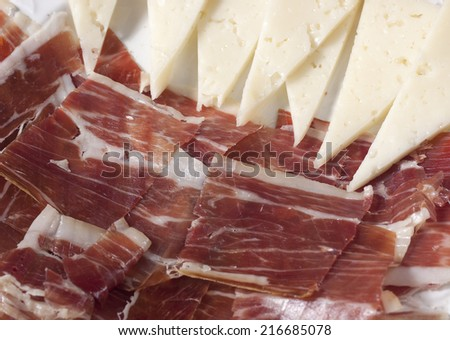 ham and manchego cheese,typical spanish - stock photo
