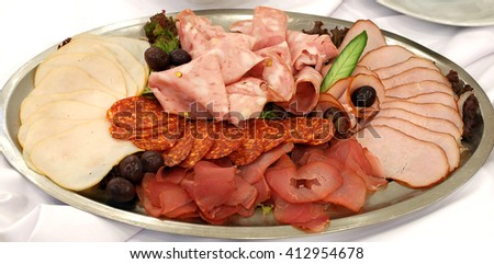 ham and salami in plate