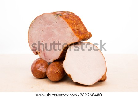 ham and sausage on a wooden board  - stock photo