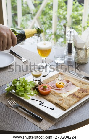 Ham cheese and egg crepe on table