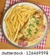 Ham & cheese omelet with french fries. - stock photo