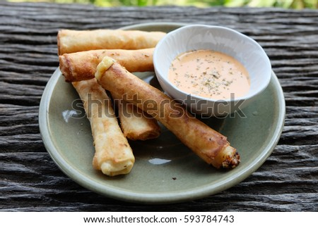 Ham cheese spring rolls on wooden table