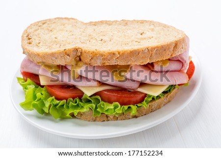 Ham, Lettuce, Cheese and Mustard Sandwich on Whole Wheat Bread - stock photo