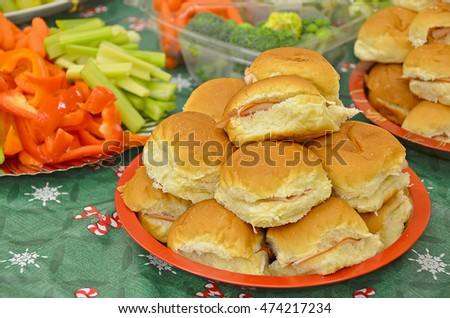ham on buns with fresh vegetable trays for Christmas party