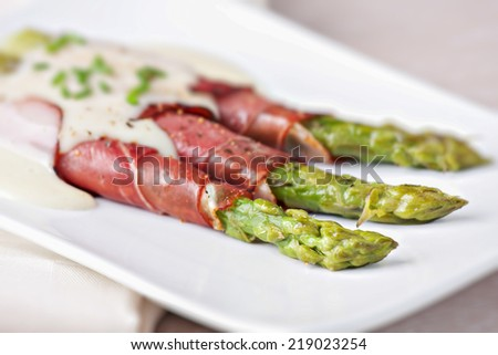 Ham rolls with asparagus and bechamel - stock photo
