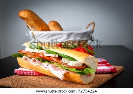 Ham, salad and tomato/mozzarella sandwich - stock photo