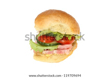 Ham salad in a crusty bread roll isolated against white