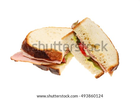 Ham salad sandwich made with crusty white bread isolated on white