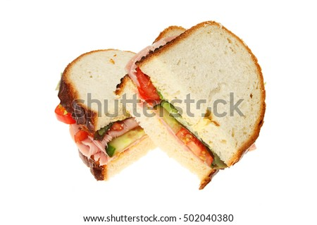 Ham salad sandwiches isolated against white