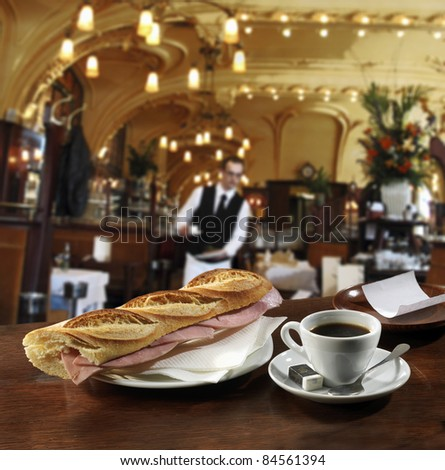 Ham sandwich and a cup of coffee on the bar in a Brasserie - stock photo