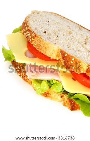 Ham Sandwich on wholewheat sourdough bread, with swiss cheese, tomatoes and lettuce.