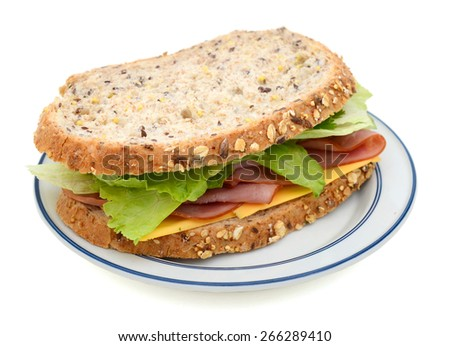 ham sandwich with cheese, salad on plate isolated on white  - stock photo