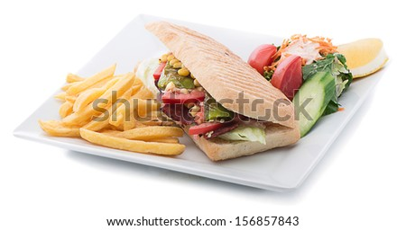 Ham sandwich with salad and french fries on the side isolated on white background