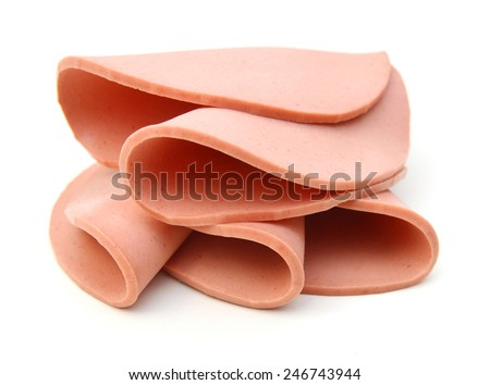 ham sausage or rolled bologna slices isolated on white background cutout  - stock photo