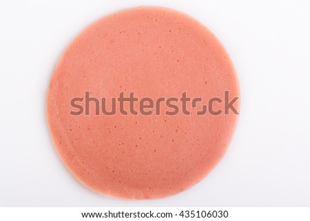 ham sausage or rolled bologna slices on white background - stock photo