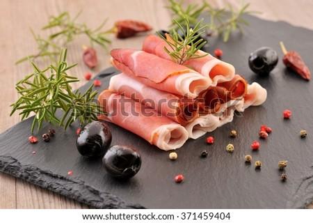 Ham. Sliced ham arranged on black plate .Prosciutto ham. Serrano ham.  - stock photo