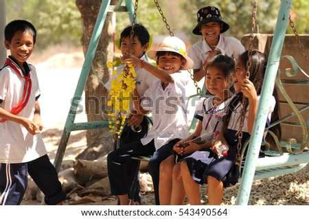 Ham Tan village, Binh Thuan province, Vietnam - March 01, 2016: Local pupil playing swing set together after school
