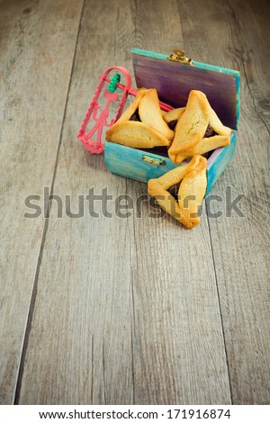 Haman ears cookies and grogger for Jewish festival of Purim - stock photo