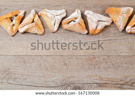 Hamantaschen cookies for Jewish festival of Purim on wooden background - stock photo