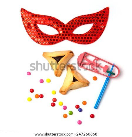 Hamantaschen cookies , grogger and carnival mask on white background - stock photo