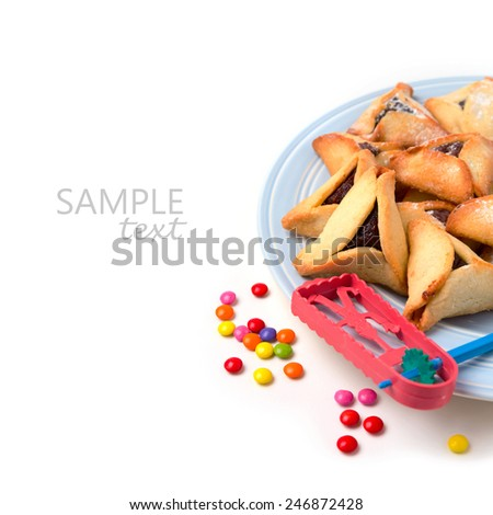 Hamantaschen cookies on plate and grogger on white background - stock photo