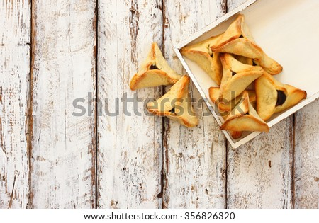 Hamantaschen cookies or hamans ears Purim celebration (jewish carnival holiday). selective focus  - stock photo