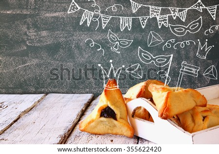 Hamantaschen cookies or hamans ears Purim celebration (jewish carnival holiday) with set of infographics - stock photo