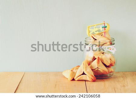 Hamantaschen cookies or hamans ears Purim celebration (jewish holiday). filtered image  - stock photo