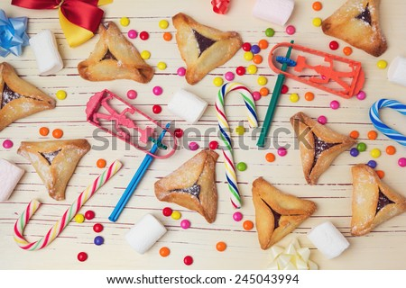 Hamantaschen cookies with candy. View from above - stock photo
