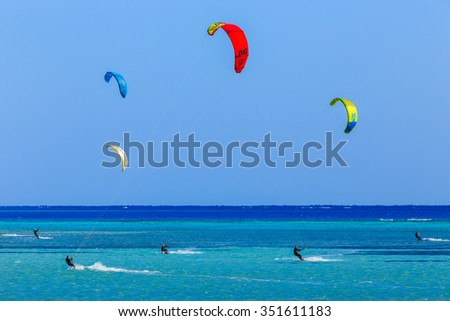 HAMATA, EGYPT - DECEMBER, 09,2015: People engaged in kite surfing in the Kite Village at the Red Sea near Hamata Marine.