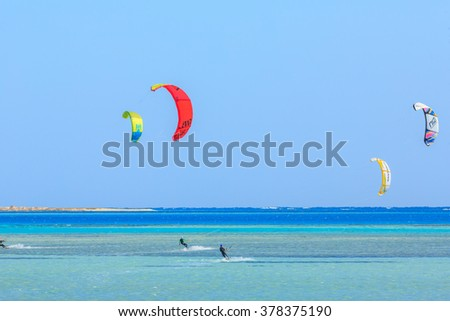 HAMATA, EGYPT - DECEMBER, 09,2015: People engaged in kite surfing in the Kite Village at the Red Sea near Hamata  Marine. - stock photo