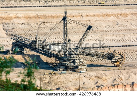 HAMBACH, GERMANY - MAY 19, 2016: One of the world's largest bucket-wheel excavators is digging lignite (brown-coal) in of the world's deepest open-pit mines in Hambach in the Ruhr area in Germany. - stock photo