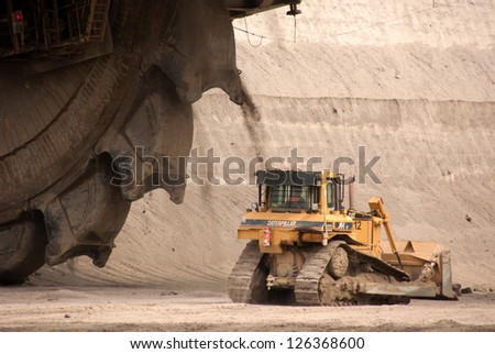 HAMBACH, GERMANY - SEPTEMBER 1, 2010: A close-up of one of the world's largest excavators and a power-shovel digging brown-coal (lignite) in an open-pit mine in Hambach, Germany on September 1, 2010. - stock photo