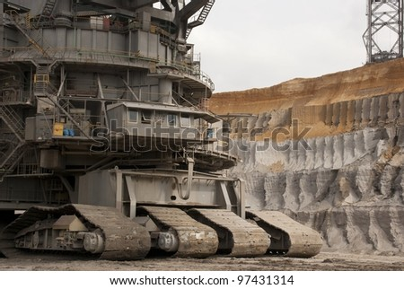 HAMBACH, GERMANY - SEPTEMBER 1: One of the world's largest bucket-wheel excavators digging for lignite (brown-coal) in of the world's deepest open-pit mines in Hambach on September 1, 2010. - stock photo