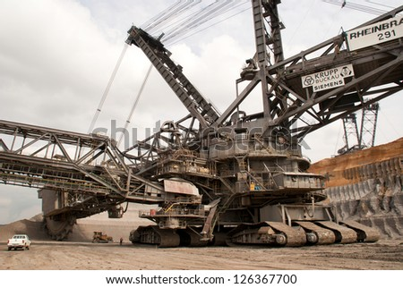 HAMBACH, GERMANY - SEPTEMBER 1, 2010: One of the world's largest excavators digging brown-coal (240,000 cubic metres per day) in one of the deepest open-pit mines in Hambach on September 1, 2010 - stock photo