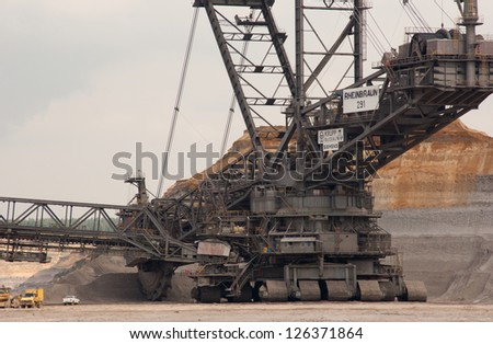 HAMBACH, GERMANY - SEPTEMBER 1, 2010: One of the world's largest excavators (225m) digging lignite (brown-coal) in one of the world's deepest open-pit mines in Hambach on September 1, 2010. - stock photo