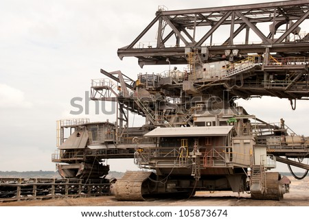 HAMBACH, GERMANY - SEPTEMBER 1: Transport vehicle attached to a large excavator and a conveyer-belt for transporting lignite in one of the world's largest mines in Hambach on September 1 - stock photo