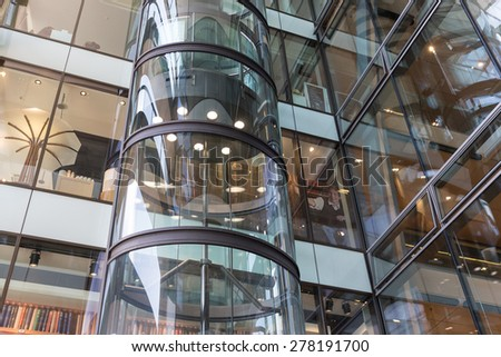 HAMBURG - APRIL 25: Glass elevator with unknown people in shopping mall 'Europassage' on April 25, 2013 in Hamburg, Germany - stock photo