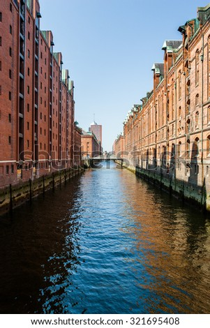 HAMBURG, GERMANY - April 16, 2009: Canal and restored traditional commercial buildings (Speicherstadt) in Hamburg, Germany. - stock photo