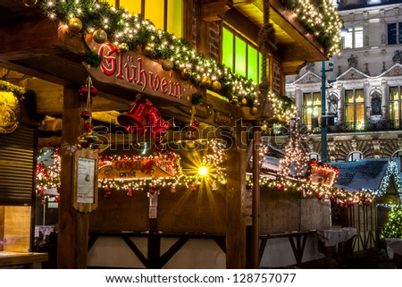 HAMBURG, GERMANY - DECEMBER 13: Christmas market with illuminated shops on December 13, 2012 in Hamburg, Germany