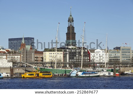 HAMBURG, GERMANY - FEBRUARY, 8. The landmark Michel (St. Michael's Church) of Hamburg (Germany) and the museum ship Rickmer Rickmers taken from the opposite riverside of the Elbe on February 8, 2015.