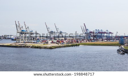 Hamburg, Germany - July 6: Container harbor with tall cranes and lots of containers in Hamburg Harbor, Germany on July 6, 2013