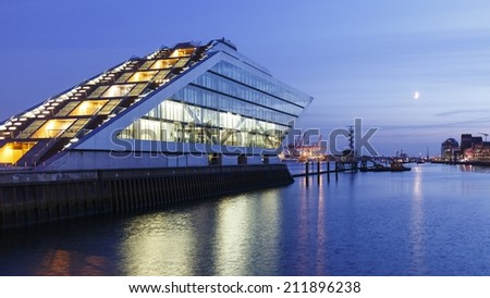 HAMBURG, GERMANY - JULY 2, 2014: Landmark office building Dockland in the harbor of Hamburg, Germany at nightfall on July 2, 2014. - stock photo